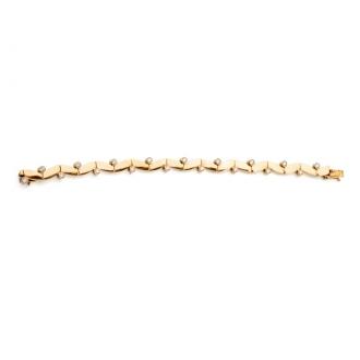 Polsera articulada, enllaçada en or i diamants. Joieries Barcelona