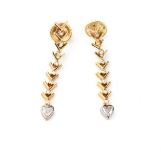 Arracades llargues en or amb brillants i un diamant cor. Joieries Barcelona