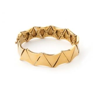 Esclava articulada en oro con motivos triangulares. Joyerías Barcelona