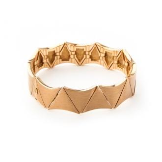 Esclava articulada en oro rosa con motivos triangulares. Joyerías Barcelona