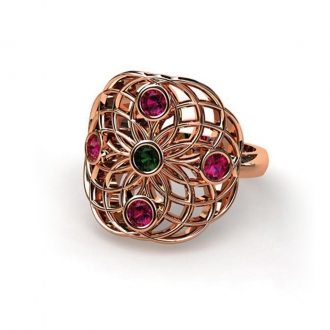 Anell en fils d'or rosa entramats, creant línies geomètriques calades amb robins i tsavorita al centre. Joieries Barcelona
