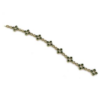 Pulsera articulada en oro con esmeraldas y diamantes